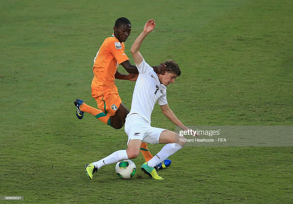 Aboubakar Keita of Ivory Coast battles with Alex Rufer of New Zealand during the FIFA U-17 World Cup UAE 2013 Group B match between New Zealand and Ivory Coast at the Mohamed Bin Zayed Stadium on October 23, 2013 in Abu Dhabi, United Arab Emirates.