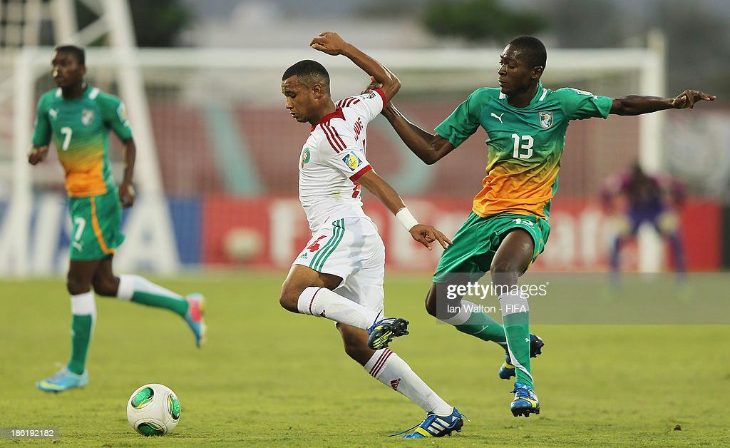 Aboubakar Keita of Ivory Coast tries to tackle Omar Arjoune of Morocco during the Round of 16 match of the FIFA U-17 World Cup between Morocco and Ivory Coast at Fujairah Stadium on October 29, 2013 in Fujairah, United Arab Emirates.