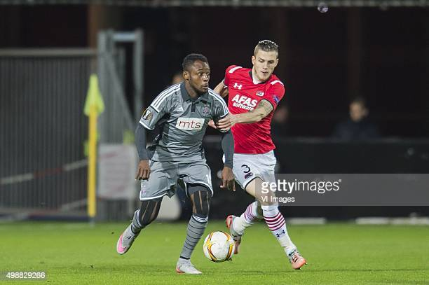 Aboubakar Oumarou of FK Partizan Jeffrey Gouweleeuw of AZ Alkmaar during the UEFA Europa League match between AZ Alkmaar and FK Partizan on November...