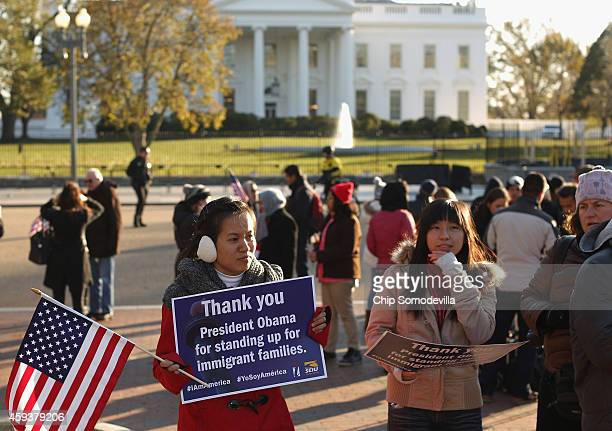 About 100 people gather to rally in support of President Barack Obama's executive action on immigration policy in Lafayette Square across from the...