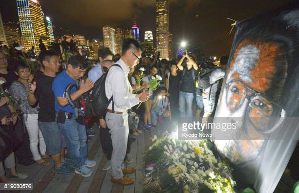 About 1000 people in Hong Kong mourn the death of Chinese Nobel Peace Prize laureate Liu Xiaobo who was imprisoned for advocating democracy in China...