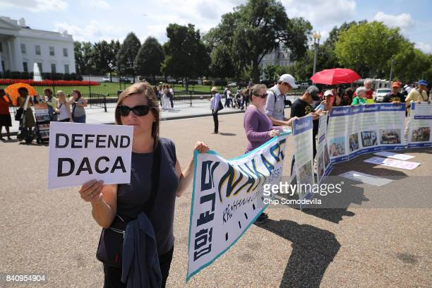 About 20 protesters demonstrate to demand immigration reform in front of the White House August 30 2017 in Washington DC Organized by The Franciscan...