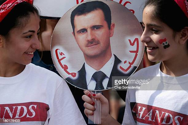 About 200 people demonstrate in support of Syrian President Bashar alAssad and against a possible military attack on Syria by the United States...