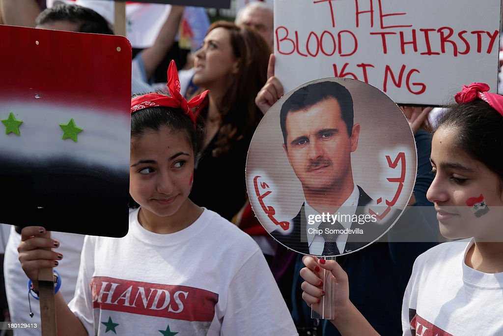 About 200 people demonstrate in support of Syrian President Bashar al-Assad and against a possible military attack on Syria by the United States outside the White House September 9, 2013 in Washington, DC. Organized by the Syrian American Forum (SAF), the demonstrators marched from the White House to the U.S. Capitol.
