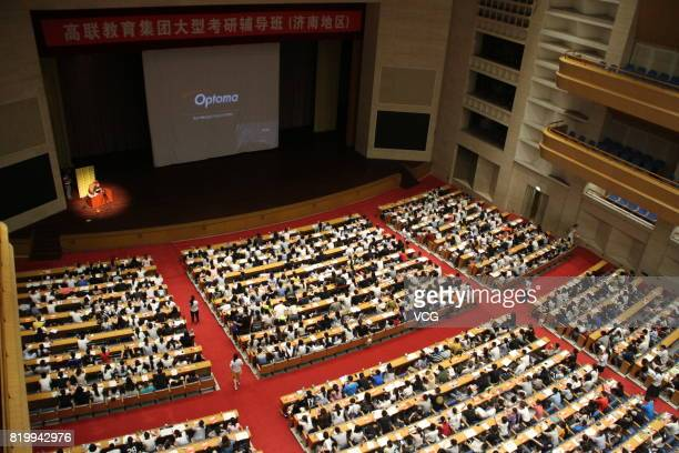 About 2000 college students take part in a tutorial and review session for postgraduate entrance examination at a hall on July 20 2017 in Jinan...