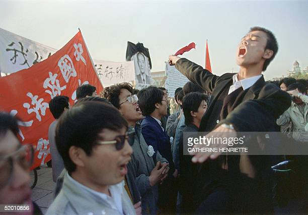 About 200000 prodemocracy protesters pack at Tiananmen Square 22 April 1989 in Beijing taking part in the funeral ceremony of former Chinese...
