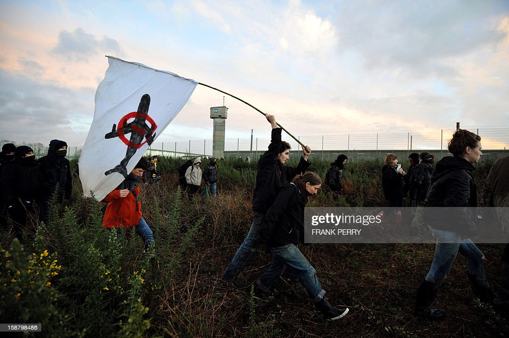 About 300 opponents to the project of an international airport in Notre-Dame-des-Landes demonstrate in front of the Nantes-Carquefou prison in support of two activists who are incarcerated, on December 29, 2012 in Nantes, western France.