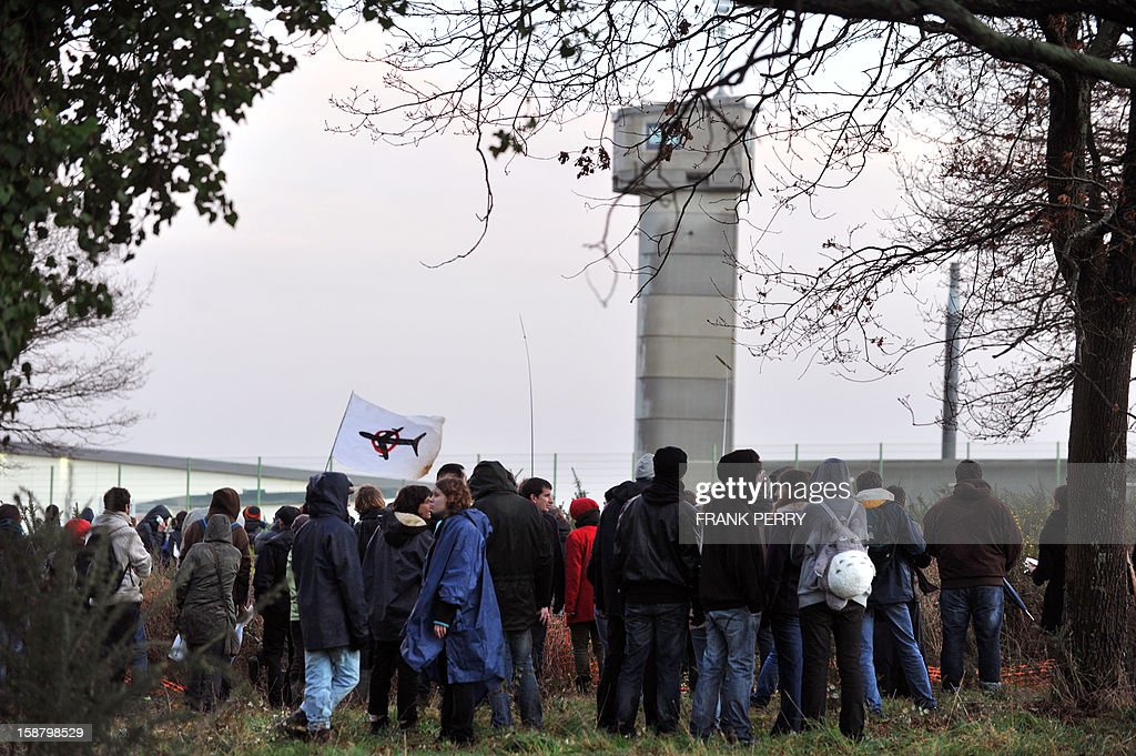 About 300 opponents to the project of an international airport in Notre-Dame-des-Landes demonstrate in front of the Nantes-Carquefou prison in support of two activists who are incarcerated, on December 29, 2012 in Nantes, western France. AFP PHOTO FRANK PERRY