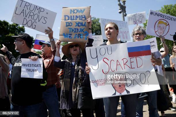 About 300 people rally to protest against President Donald Trump's firing of Federal Bureau of Investigation Director James Comey outside the White...