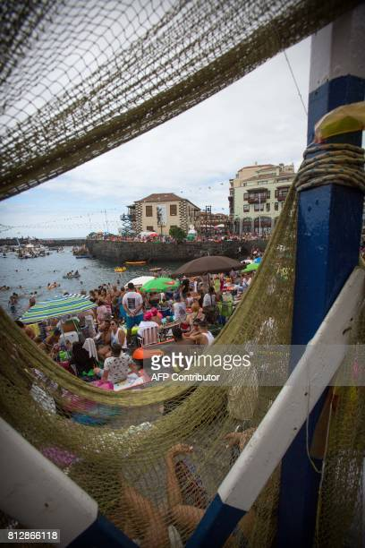 About 35000 people wait for the boat procession of the Virgen del Carmen patron saint of fishermen at Puerto de la Cruz on Spain's Canary island of...