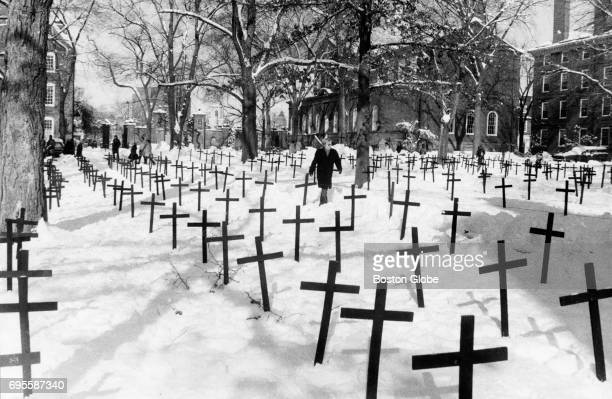 About 500 black wooden crosses sit in the snow in Harvard Yard at Harvard University in Cambridge Mass on March 6 1972 Students and members of the...