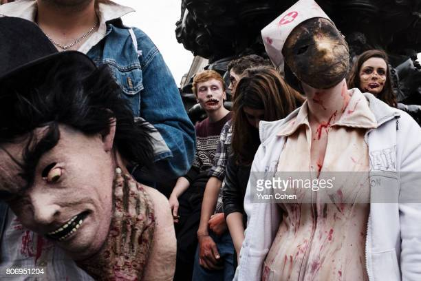 About a 100 zombies descended on central London to mark world Zombie day They swarmed around Picadilly Circus thrilling and terrifying tourists and...