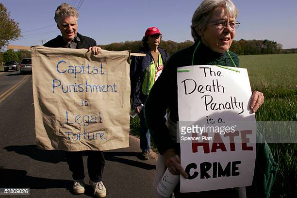 About a dozen antideath penalty campaigners march to the Osborn Correctional Institution May 12 2005 in Somers Connecticut After fighting off...
