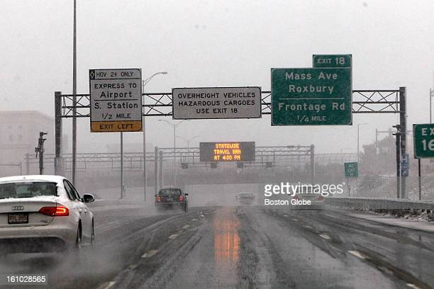 About an hour before the Governor's travel ban was to take effect cars make their way northbound on the Expressway as signs warn that traffic will be...