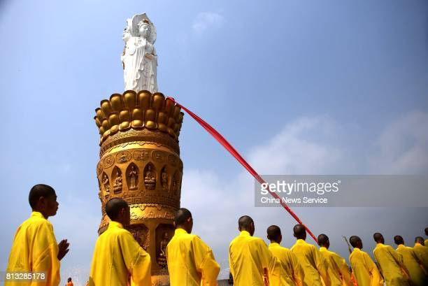 About one thousand Chinese monks pray around the statue of Guanyin during a blessing ceremony on July 12 2017 in Nanyang Henan Province of China The...