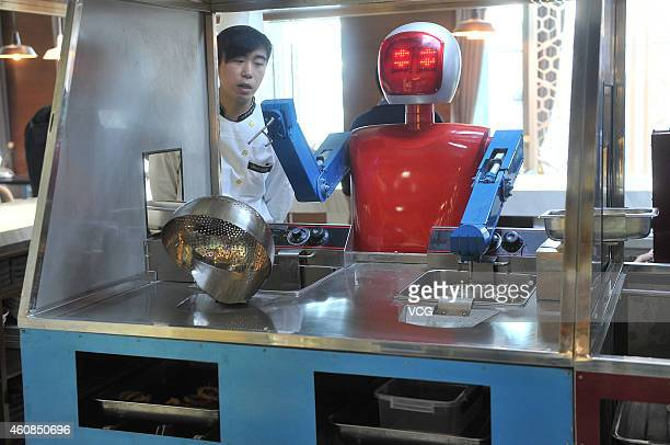 About thirty robots waiters work at a dining hall on December 26 2014 in Hefei Anhui province of China A dining hall named 'WallE' opened in Hefei...