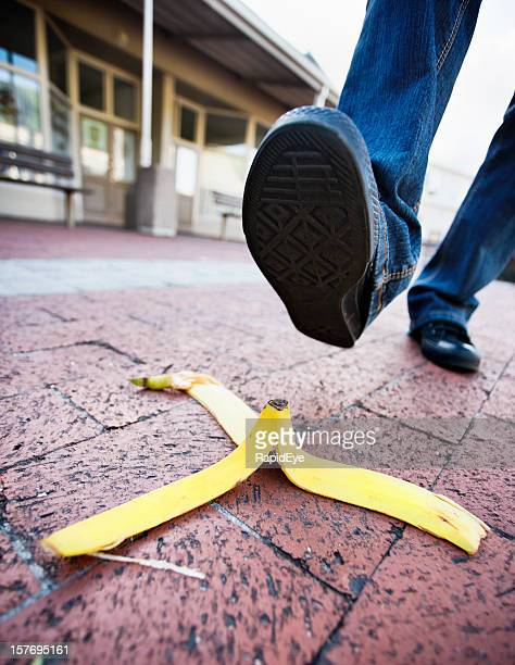 About to step on banana peel in paved shopping complex