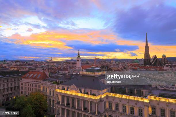 Above Beautiful Vienna Cityscape panorama, with St. Stephen's Cathedral, impressive building architecture and urban skyline at dramatic sunset – Vienna , Austria