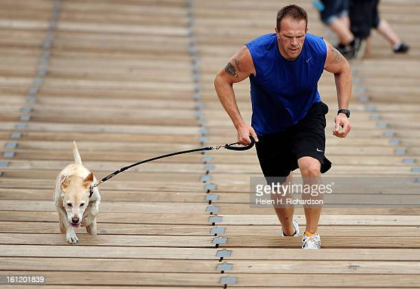 Josh Bollwahn runs up the seats in the Red Rocks Amphitheater with his dog Susie There are 69 rows of seats from the stage to the top of the...