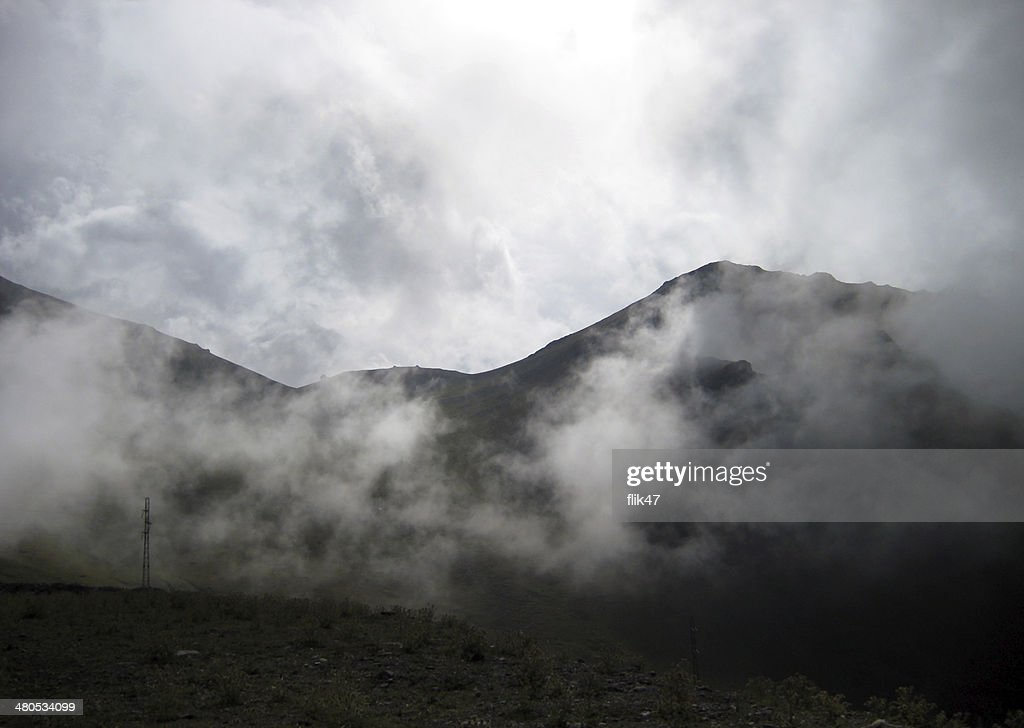 Above the clouds. Pass in  mountains : Stock Photo