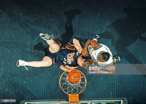 Above the hoop view of American basketball player Andrea LloydCurry of the Columbus Quest as she scores against Vicki Plowden of the New England...