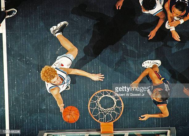 Above the hoop view of American basketball player Shanda Berry of the New England Blizzard as she reaches for the ball during a game against the...
