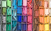A box of colorful artist's pastels.