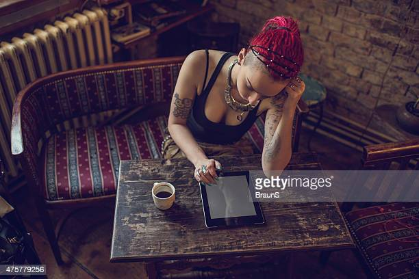 Above view of a woman using electronic organizer at cafe.