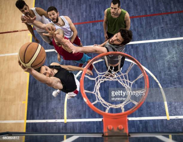 Above view of basketball players in action on a court.
