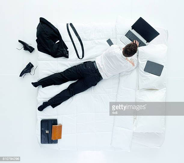 Above view of businessman working on laptop