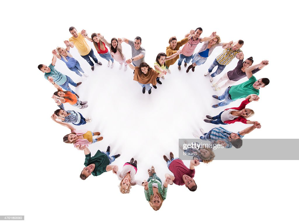 Above view of group of young people making heart shape. : Stock Photo