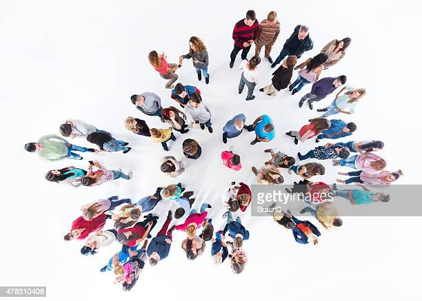 Above view of large group of smiling people communicating.