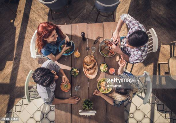Above view of young people having healthy lunch in a restaurant.
