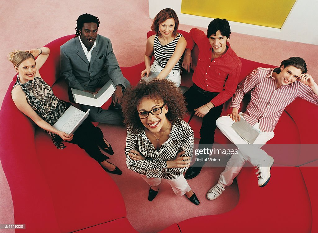 Above View Portrait of a Group of Businessmen and Businesswomen Sitting and Standing in a Modern Office : Stock Photo
