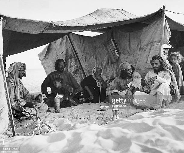 Abqaiq Al Hasa Saudi Arabia A Bedouin man entertaining friends in his tent in the desert near Abqaiq this Arab is a watchman employed by Aramco The...