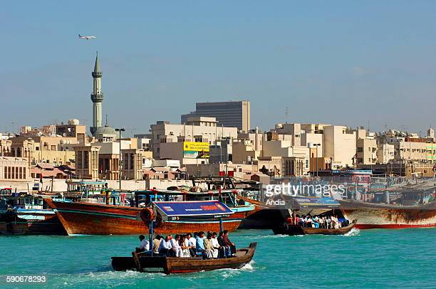 Abra water taxi crisscrossing the Dubai Creek between Bur Dubai and Deira view towards Deira Dubai United Arab Emirates