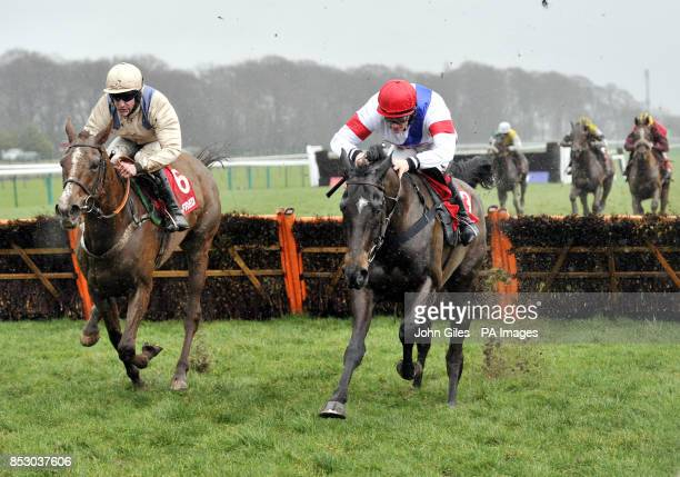 Abracadabra Sivola ridden by Sam TwistonDavies lead over the final hurdle as they win the Betfred Goals Galore Victor Ludorum Juvenile Hurtdle Race...