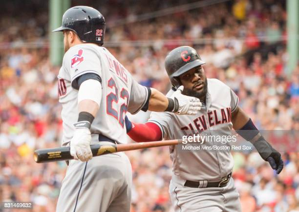 Abraham Almonte of the Cleveland Indians celebrates a run scored against the Boston Red Sox with Jason Kipnis in the second inning on August 14 2017...