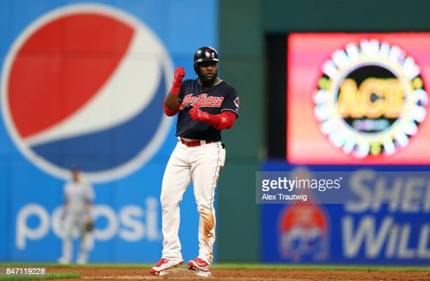 Abraham Almonte of the Cleveland Indians celebrates after hitting a double in the bottom of the third inning of the game against the Kansas City...