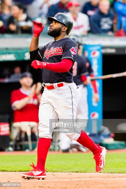 Abraham Almonte of the Cleveland Indians celebrates as he runs home on a solo home run during the fifth inning against the Houston Astros at...