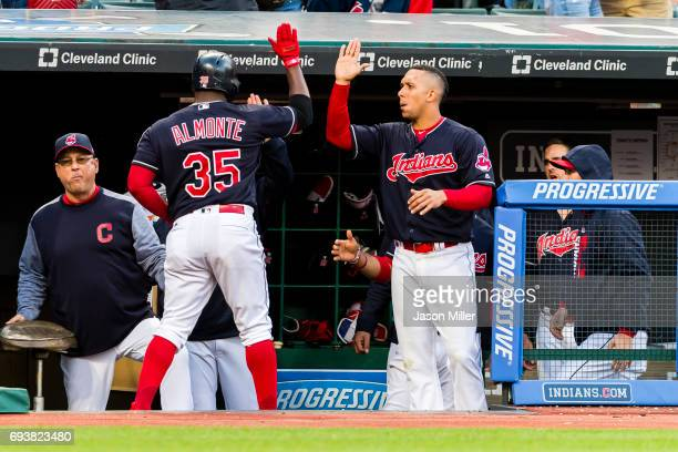 Abraham Almonte of the Cleveland Indians celebrates with Michael Brantley after Abraham Almonte scores on a solo home run during the fifth inning...