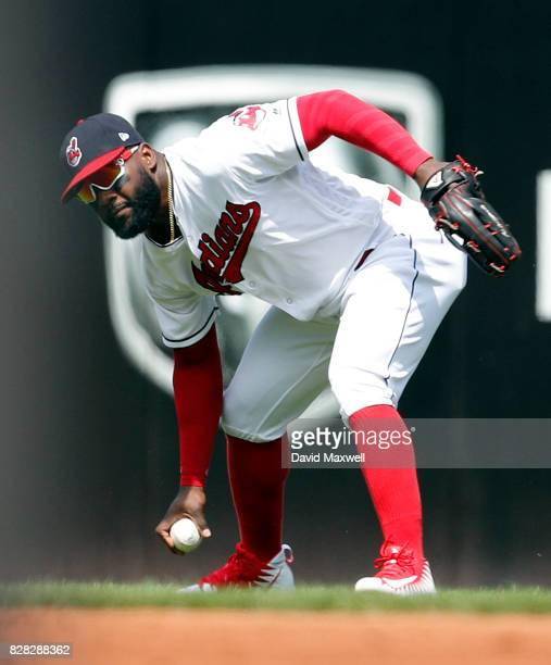 Abraham Almonte of the Cleveland Indians fields a ball hit into a fielders choice by Jonathan Lucroy of the Colorado Rockies in the second inning at...