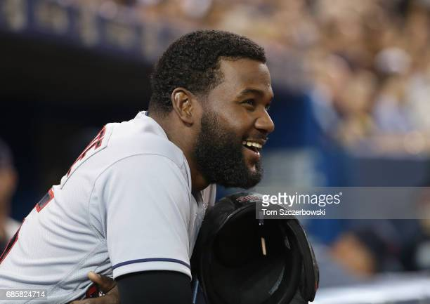 Abraham Almonte of the Cleveland Indians laughs as he looks on from the top step of the dugout during MLB game action against the Toronto Blue Jays...