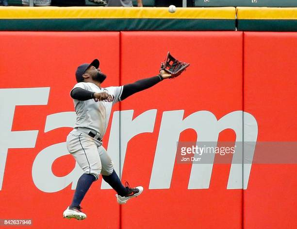 Abraham Almonte of the Cleveland Indians makes a leaping catch for an out on a fly ball hit by Matt Davidson of the Chicago White Sox during the...