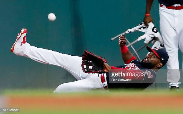 Abraham Almonte of the Cleveland Indians makes a sliding attempt on a double by Eric Hosmer of the Kansas City Royals during the sixth inning at...
