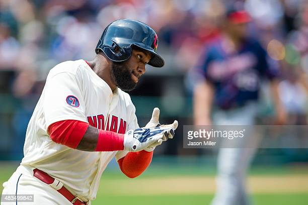 Abraham Almonte of the Cleveland Indians reacts after hitting a two run home run against starting pitcher Phil Hughes of the Minnesota Twins during...