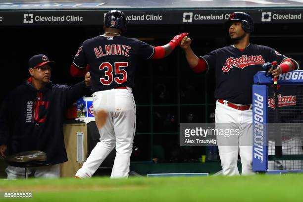 Abraham Almonte of the Cleveland Indians returns to the dugout after scoring during the game against the Kansas City Royals at Progressive field on...