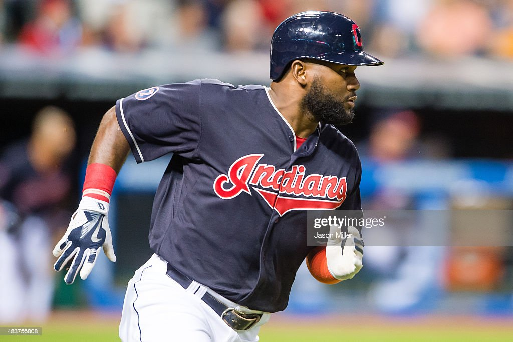 Abraham Almonte #35 of the Cleveland Indians runs out an RBI single scoring Carlos Santana during the sixth inning against the New York Yankees at Progressive Field on August 12, 2015 in Cleveland, Ohio.