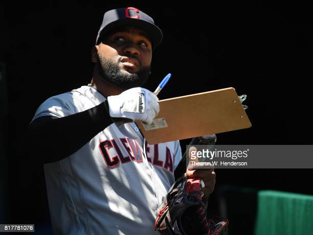 Abraham Almonte of the Cleveland Indians signs autographs for fans prior to the start of the game against the Oakland Athletics at Oakland Alameda...