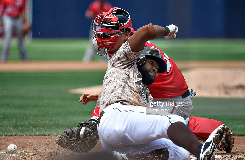Abraham Almonte #16 of the San Diego Padres scores as Jose Lobaton #59 of the Washington Nationals loses the ball during the first inning of a baseball game at Petco Park May 17, 2015 in San Diego, California.